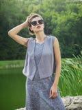 Jovem mulher bonita em um vestido do verão Imagens de Stock