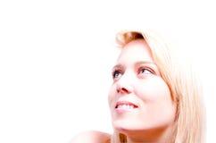 Jovem mulher bonita que olha feliz em seu lado superior Imagens de Stock
