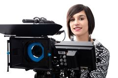 Jovem mulher com câmara de vídeo profissional, SLR, em branco imagens de stock royalty free