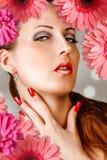 Mulher com chicotes, pregos, bordos vermelhos Imagens de Stock Royalty Free