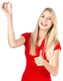 Jovem mulher com comprimido ou cápsula Fotografia de Stock