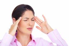 Jovem mulher com dor de cabeça. Imagem de Stock