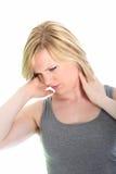 Jovem mulher com dor do pescoço imagem de stock royalty free