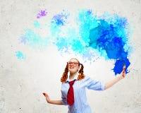Jovem mulher com escova de pintura Fotografia de Stock Royalty Free