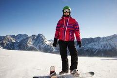 Jovem mulher com um snowboard Imagens de Stock