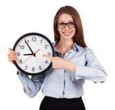 Mulher com uma camisa cinzenta com horas de escritório fotografia de stock royalty free