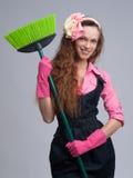 Jovem mulher com vassoura Imagens de Stock