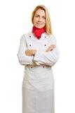 Jovem mulher como o cozinheiro na aprendizagem Foto de Stock