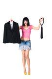 A menina escolhe a roupa Foto de Stock Royalty Free