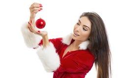 Jovem mulher deleitada que guarda a quinquilharia vermelha Imagens de Stock