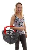 A jovem mulher está fazendo grocerys Imagens de Stock
