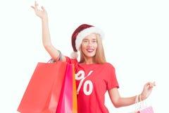 Jovem mulher feliz com chapéu de Santa imagem de stock royalty free