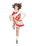 Jovem mulher na dança irlandesa do vestido da dança isolada Fotos de Stock Royalty Free