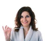 A jovem mulher na veste de banho sobre o branco isolou o fundo Fotos de Stock Royalty Free