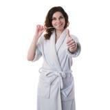 A jovem mulher na veste de banho sobre o branco isolou o fundo Foto de Stock