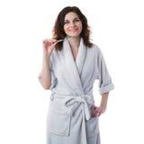 A jovem mulher na veste de banho sobre o branco isolou o fundo Imagens de Stock