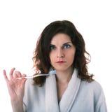 A jovem mulher na veste de banho sobre o branco isolou o fundo Imagem de Stock