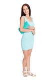 Jovem mulher no vestido de turquesa no crescimento completo Imagens de Stock