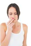 Jovem mulher ocasional com nariz do sangramento fotos de stock royalty free