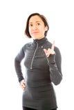 Jovem mulher que aponta seu dedo acima Fotografia de Stock