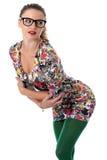 Jovem mulher que dobra-se para a frente em Mini Dress Wearing Glasses Imagem de Stock