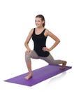 Jovem mulher que faz exercícios Fotos de Stock