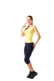 Jovem mulher que faz a ginástica aeróbica e o esticão, isolados no fundo branco Foto de Stock Royalty Free
