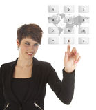 Jovem mulher que faz uma chamada telefônica virtual fotografia de stock royalty free