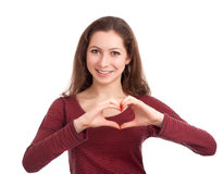 Jovem mulher que forma a forma do coração com mãos Imagem de Stock