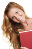 Jovem mulher que guarda o livro vermelho Fotos de Stock Royalty Free