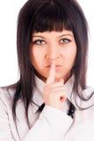 Mulher que gesticula para silenciar Imagens de Stock Royalty Free