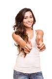 Jovem mulher que mostra os polegares acima Fotografia de Stock