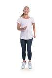 Jovem mulher que movimenta-se sobre o fundo branco Imagens de Stock