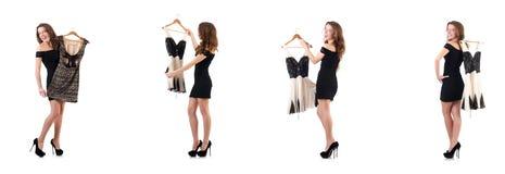 A jovem mulher que tenta a roupa nova no branco Imagens de Stock Royalty Free