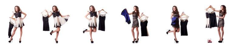 A jovem mulher que tenta a roupa nova no branco Fotografia de Stock Royalty Free