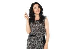 Jovem mulher que usa o telefone Fotografia de Stock Royalty Free