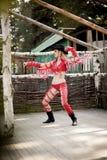 Jovem mulher que veste o vestido vermelho do vaqueiro Imagem de Stock Royalty Free