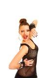 Jovem mulher sedutor que pisc e que mostra a língua isolada no whi Fotografia de Stock Royalty Free