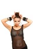Jovem mulher 'sexy' que faz chifres com suas mãos isoladas em b branco Fotografia de Stock Royalty Free