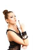 Jovem mulher 'sexy' que faz um gesto da arma isolado no backgrou branco Imagem de Stock Royalty Free