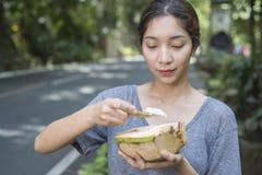 Jovem senhora With Coconut Imagem de Stock Royalty Free