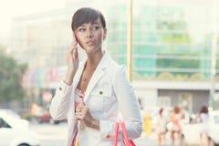 Jovem senhora no revestimento branco Imagem de Stock Royalty Free
