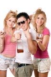 Jovens alegres com um frasco Fotografia de Stock Royalty Free