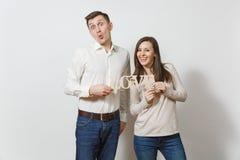 Jovens europeus bonitos em um fundo branco Emoções, conceito de família Fotos de Stock Royalty Free