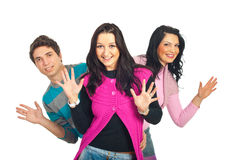 Jovens felizes que mostram as palmas imagem de stock