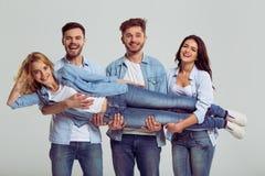 Jovens nas calças de brim Imagem de Stock Royalty Free