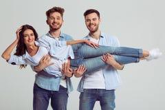 Jovens nas calças de brim Fotos de Stock