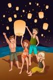 Jovens que liberam as lanternas de papel Imagens de Stock