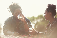 Jovial couple with dark complexion on a date together outdoors Royalty Free Stock Photos