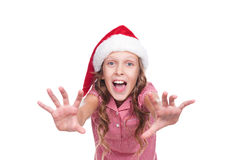 Jovial girl in santa claus hat Stock Images